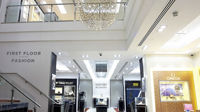 Hugh Rice, Harrogate: Shop the space - customers are enticed to the upper floor via a dramatic open staircase with a full height sculptured plaster wall and bespoke chandeliers